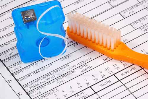 Dental claim form with toothbrush