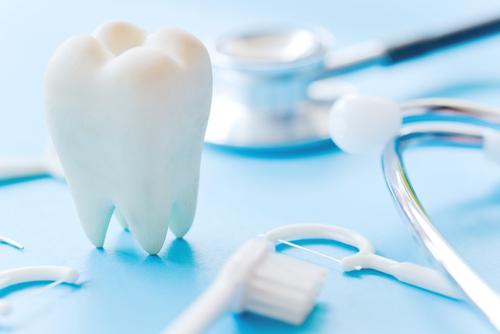 Dental model and dental equipment on blue background